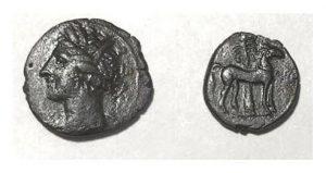 Карфагенская монета в полшекеля (ок. 210 г. до н.э. 15мм, 2г). Изображение богини Танит, реверс: лошадь и пальма